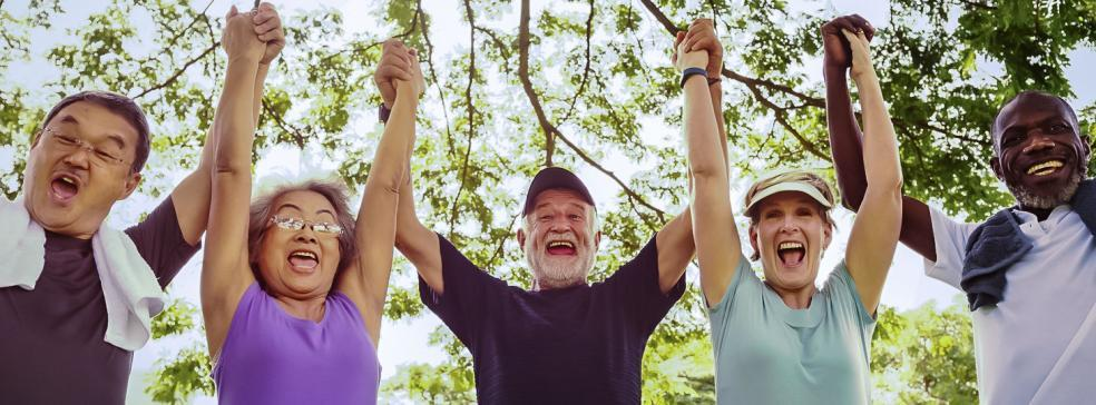 Image of senior friends being active and exercising in a park